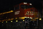 The LED Road Number Lights of BNSF 6637 stand out with her BNSF reflective Swoosh Logo in this Night Flash Shot as she waits for a crew too take her eastbound pushing the Z LAC-CLO